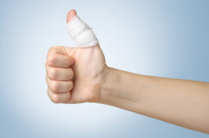 Bandaged thumb held up as good to go